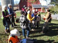 Conrad Vispo teaches participants on a winter ecology walk about a coniferous tree.